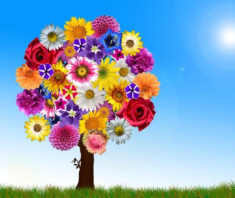 ein Baum in dessen Krone lauter Blüten unterschiedlicher Blumen etwas kitschig aber wunderschön bunt gezeichnet sind
